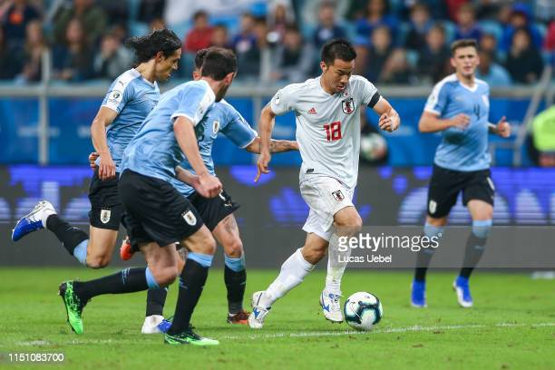 Edinson Cavani of Uruguay battles for the ball against Shinji Okazaki of Japan during the Copa America Brazil 2019 group C match between Uruguay and...