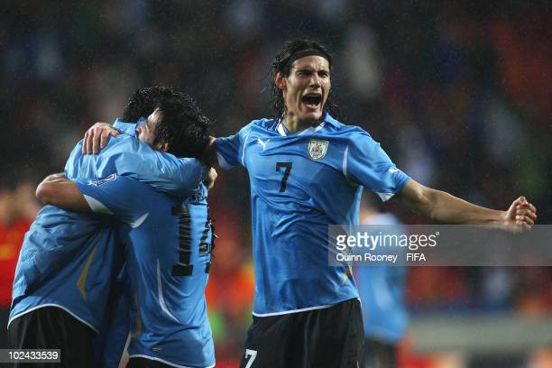 Edinson Cavani of Uruguay celebrates after the 2010 FIFA World Cup South Africa Round of Sixteen match between Uruguay and South Korea at Nelson...
