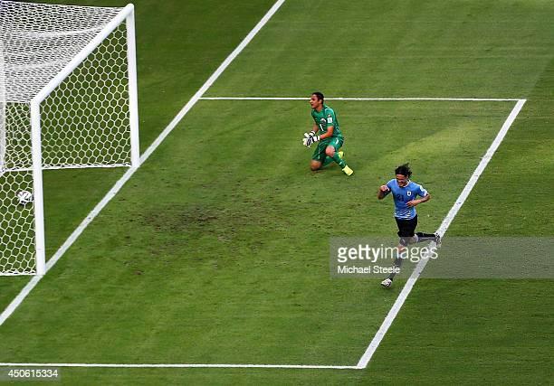 Edinson Cavani of Uruguay celebrates scoring his team's first goal on a penalty kick past Keylor Navas of Costa Rica during the 2014 FIFA World Cup...
