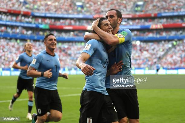 Edinson Cavani of Uruguay celebrates with teammate Diego Godin after scoring his team's third goal during the 2018 FIFA World Cup Russia group A...