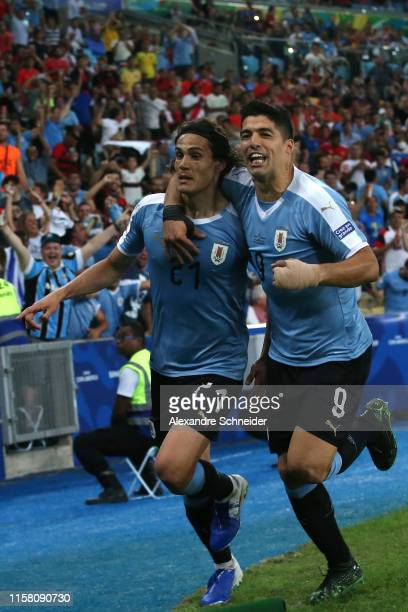 Edinson Cavani of Uruguay celebrates with teammate Luis Suarez after scoring the first goal of his team during the Copa America Brazil 2019 group C...