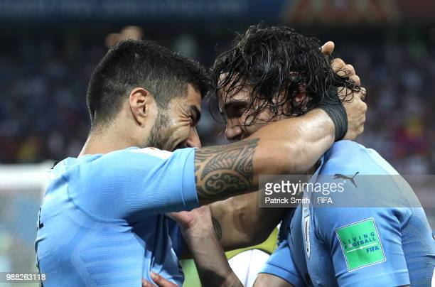 Edinson Cavani of Uruguay celebrates with teammate Luis Suarez after scoring his team's second goal during the 2018 FIFA World Cup Russia Round of 16...