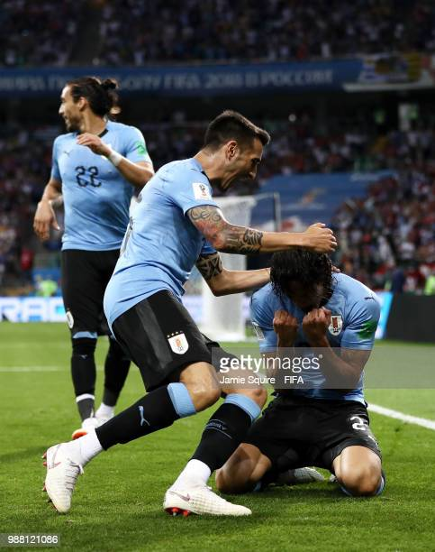 Edinson Cavani of Uruguay celebrates with teammates after scoring his team's first goal during the 2018 FIFA World Cup Russia Round of 16 match...