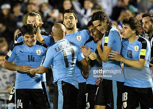 Edinson Cavani of Uruguay celebrates with teammates after scoring the third goal of his team during a match between Uruguay and Venezuela as part of...