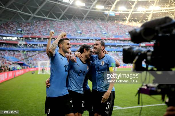 Edinson Cavani of Uruguay celebrates with teammates Diego Godin and Matias Vecino after scoring his team's third goal during the 2018 FIFA World Cup...