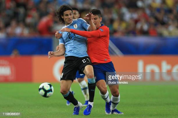 Edinson Cavani of Uruguay competes for the ball with Igor Lichnovsky of Chile during the Copa America Brazil 2019 group C match between Chile and...