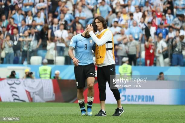 Edinson Cavani of Uruguay consoles Luis Suarez of Uruguay following Uruguay's defeat during the 2018 FIFA World Cup Russia Quarter Final match...