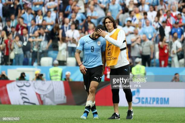 Edinson Cavani of Uruguay consoles Luis Suarez of Uruguay following Uruguay's defeat during the 2018 FIFA World Cup Russia Quarter Final match...