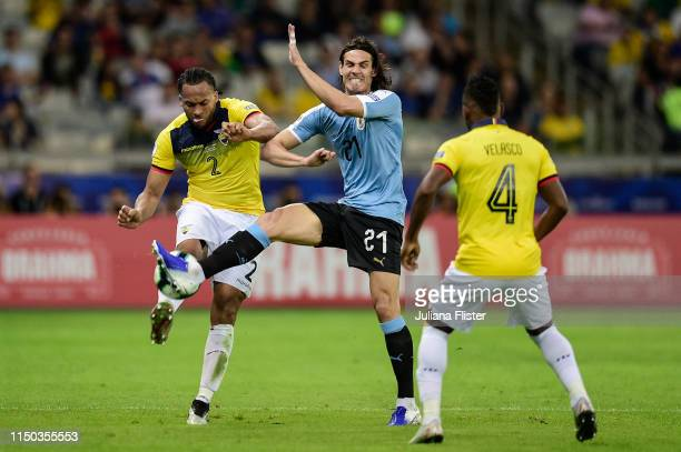 Edinson Cavani of Uruguay fights for the ball with Arturo Mina of Ecuador during the Copa America Brazil 2019 group C match between Uruguay and...