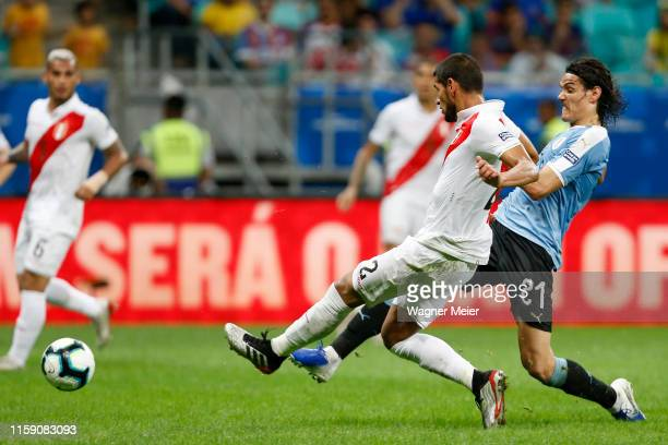 Edinson Cavani of Uruguay fights for the ball with Luis Abram of Peru during the Copa America Brazil 2019 quarterfinal match between Uruguay and Peru...