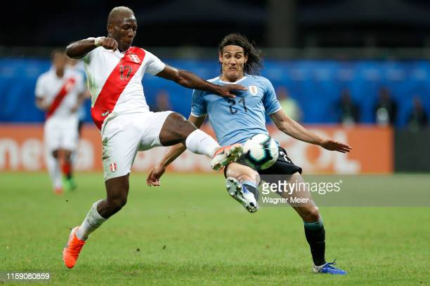 Edinson Cavani of Uruguay fights for the ball with Luis Advincula of Peru during the Copa America Brazil 2019 quarterfinal match between Uruguay and...