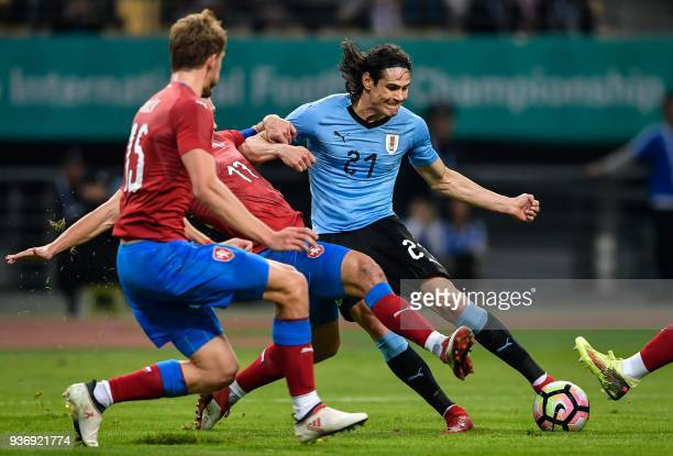 TOPSHOT Edinson Cavani of Uruguay fights for the ball with Marek Suchy of Czech during their China Cup International Football Championship Semifinal...
