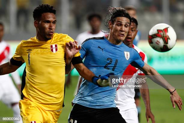 Edinson Cavani of Uruguay fights for the ball with Pedro Gallese of Peru during a match between Peru and Uruguay as part of FIFA 2018 World Cup at...