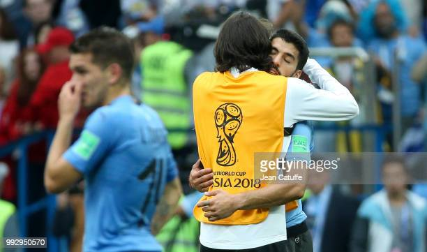 Edinson Cavani of Uruguay greets teammate Luis Suarez following the 2018 FIFA World Cup Russia Quarter Final match between Uruguay and France at...