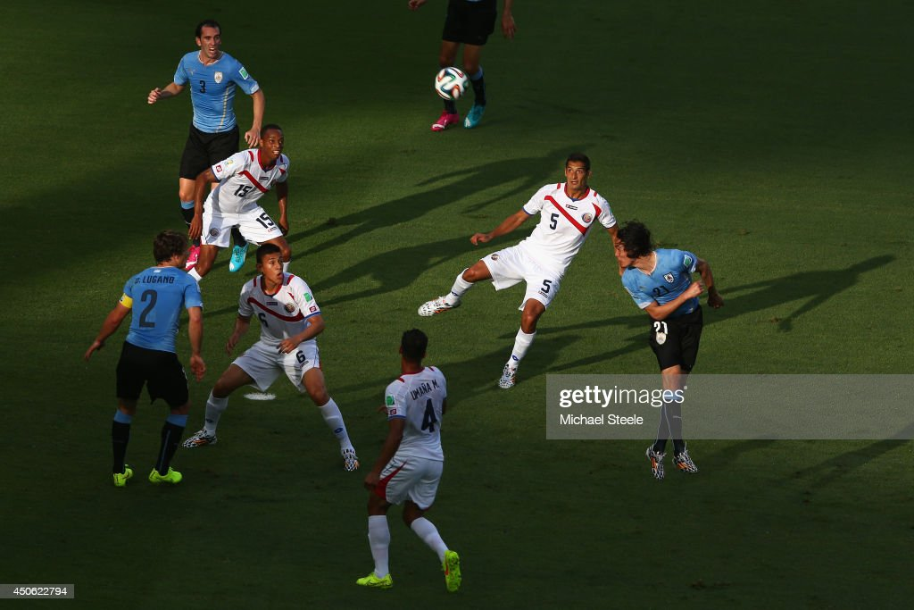 Edinson Cavani (R)of Uruguay heads goalwards during the 2014 FIFA World Cup Brazil Group D match between Uruguay and Costa Rica at Castelao on June 14, 2014 in Fortaleza, Brazil.
