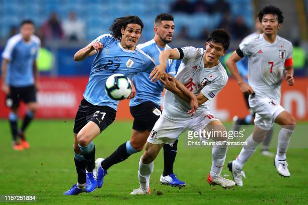 Edinson Cavani of Uruguay in action with of Takehiro Tomiyasu of Japan during the Copa America Brazil 2019 group C match between Uruguay and Japan at...