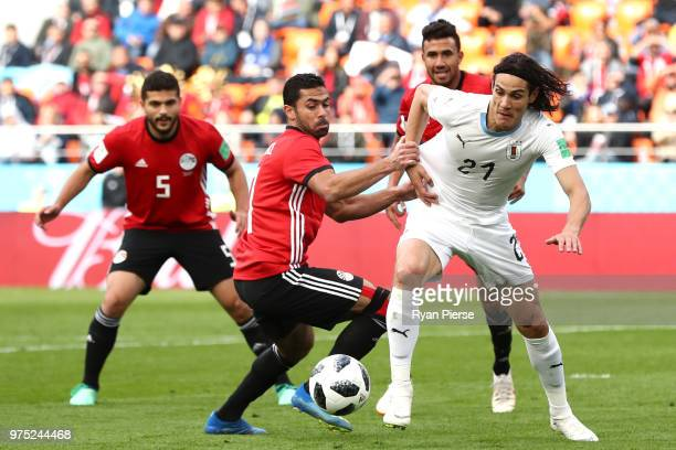 Edinson Cavani of Uruguay is challenged by Ahmed Fathi of Egypt during the 2018 FIFA World Cup Russia group A match between Egypt and Uruguay at...