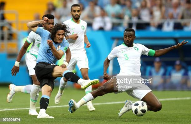 Edinson Cavani of Uruguay is tackled by Osama Hawsawi during the 2018 FIFA World Cup Russia group A match between Uruguay and Saudi Arabia at Rostov...