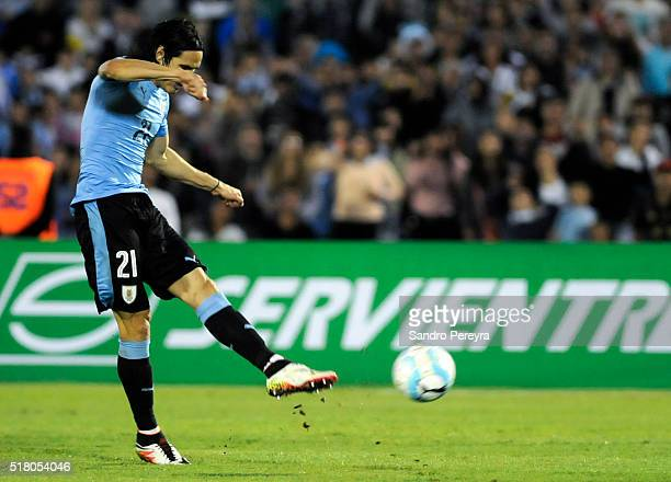 Edinson Cavani of Uruguay kicks to score during a match between Uruguay and Peru as part of FIFA 2018 World Cup Qualifiers at Centenario Stadium on...