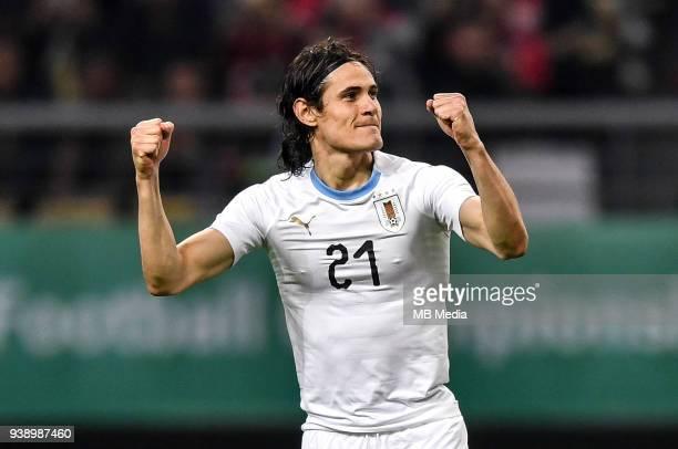 Edinson Cavani of Uruguay national football team poses to celebrate after scoring against Wales national football team in their final match during...