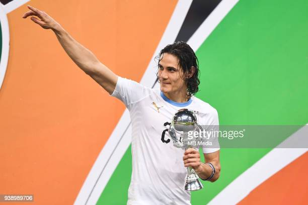Edinson Cavani of Uruguay national football team poses with his trophy after defeating Wales national football team in their final match during the...