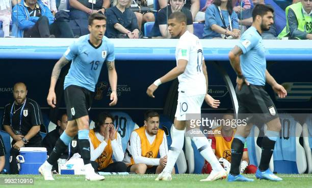 Edinson Cavani of Uruguay on the bench while Kylian Mbappe of France and Luis Suarez of Uruguay look on during the 2018 FIFA World Cup Russia Quarter...