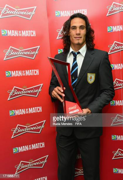 Edinson Cavani of Uruguay poses with the Man of the Match award after the FIFA Confederations Cup Brazil 2013 3rd Place match between Uruguay and...