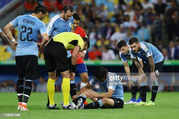 Edinson Cavani of Uruguay reacts after being injured during the Copa America Brazil 2019 group C match between Chile and Uruguay at Maracana Stadium...