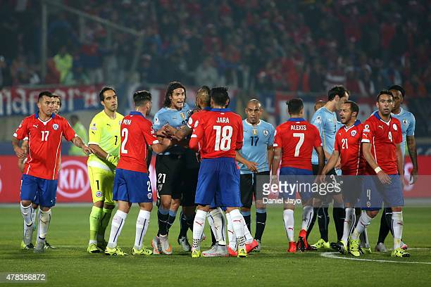 Edinson Cavani of Uruguay reacts after being sent off during the 2015 Copa America Chile quarter final match between Chile and Uruguay at Nacional...