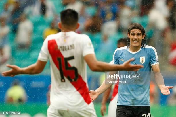 Edinson Cavani of Uruguay reacts to Carlos Zambrano of Peru during the Copa America Brazil 2019 quarterfinal match between Uruguay and Peru at Arena...