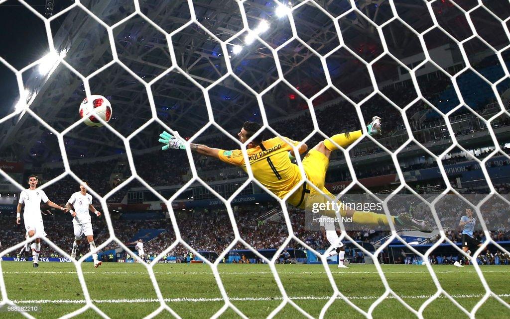 Edinson Cavani of Uruguay scores his team's second goal past Rui Patricio of Portugal during the 2018 FIFA World Cup Russia Round of 16 match between Uruguay and Portugal at Fisht Stadium on June 30, 2018 in Sochi, Russia.