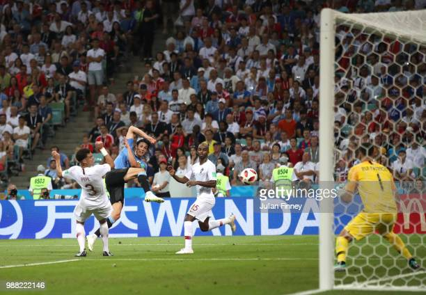Edinson Cavani of Uruguay shoots on target under pressure from Pepe and Ricardo of Portugal during the 2018 FIFA World Cup Russia Round of 16 match...