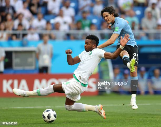 Edinson Cavani of Uruguay shoots past Ali Albulayhi of Saudi Arabia during the 2018 FIFA World Cup Russia group A match between Uruguay and Saudi...