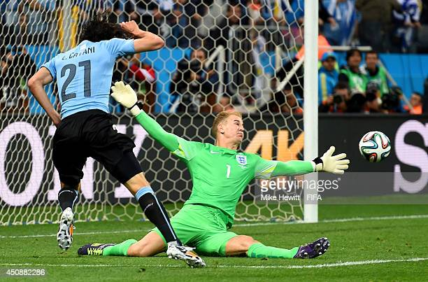 Edinson Cavani of Uruguay shoots while Joe Hart of England tries to stop during the 2014 FIFA World Cup Brazil Group D match between Uruguay and...
