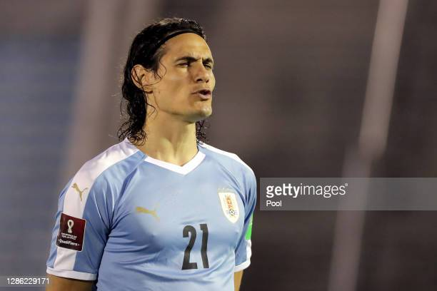 Edinson Cavani of Uruguay sings the national anthem before a match between Uruguay and Brazil as part of South American Qualifiers for World Cup FIFA...