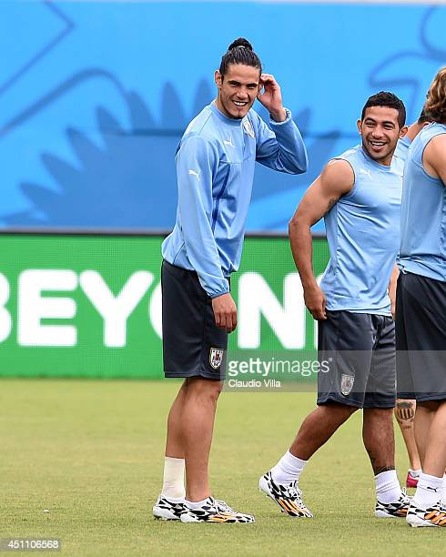 Edinson Cavani of Uruguay smiles during training session at the Dunas Arena in Natal on June 23 2014 in Natal Brazil