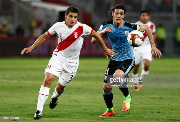 Edinson Cavani of Uruguay struggles for the ball with Aldo Corzo of Peru during a match between Peru and Uruguay as part of FIFA 2018 World Cup at...