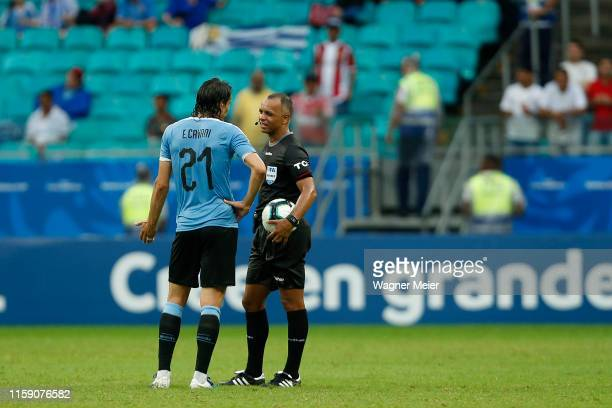 Edinson Cavani of Uruguay talks with Referee Raphael Claus during the Copa America Brazil 2019 quarterfinal match between Uruguay and Peru at Arena...