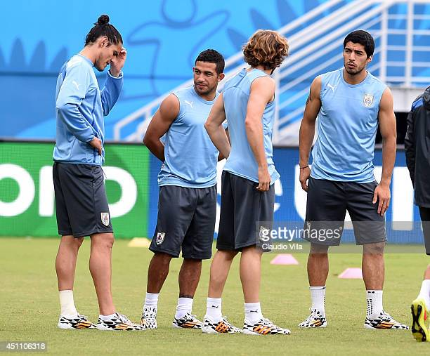 Edinson Cavani Walter Gargano Diego Forlan and Luis Suarez of Uruguay during a training session at the Dunas Arena in Natal on June 23 2014 in Natal...