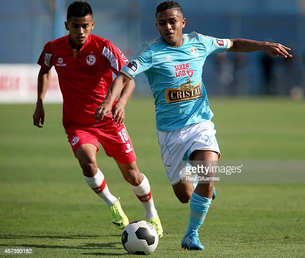 Edinson Chavez of Sporting Cristal struggles for the ball with Segundo Acevedo of Juan Aurich during a match between Sporting Cristal and Juan Aurich...