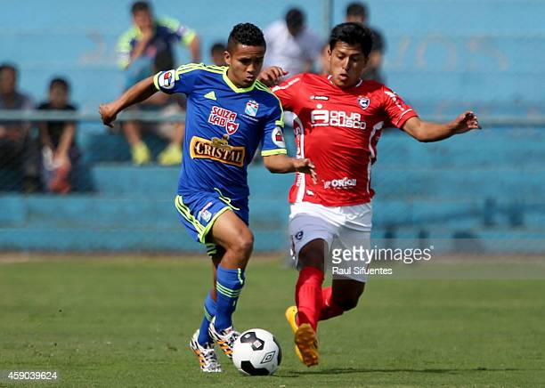 Edinson Chavez of Sporting Cristal struggles for the ball with Herbert Castillo of Cienciano during a match between Sporting Cristal and Cienciano as...