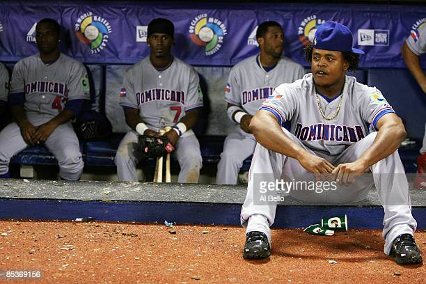 Edinson Volquez Damaso Marte Jose Reyes and Robinson Cano of the Dominican Republic react after losing 21 against the Netherlands during the 2009...