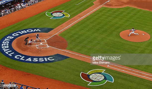 Edinson Volquez of the Dominican Republic pitches during a World Baseball Classic second round game against Italy at Marlins Park on March 12 2013 in...