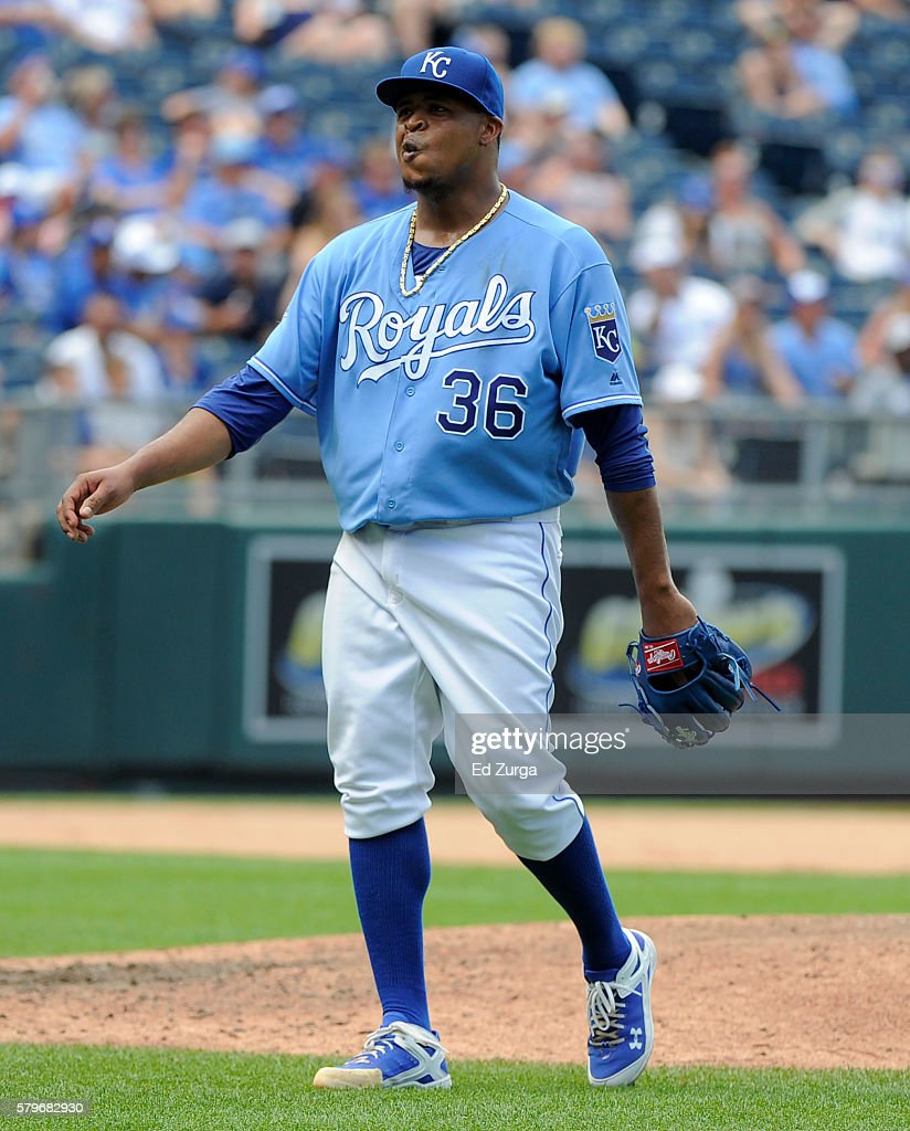 Edinson Volquez #36 of the Kansas City Royals reacts after giving up an RBI single to Mitch Moreland of the Texas Rangers in the sixth inning at Kauffman Stadium on July 24, 2016 in Kansas City, Missouri.