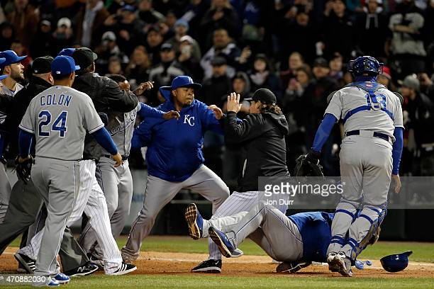 Edinson Volquez of the Kansas City Royals throws a punch towards Jeff Samardzija of the Chicago White Sox during a bench clearing fight on April 23...
