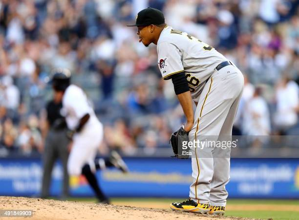 Edinson Volquez of the Pittsburgh Pirates reacts after Alfonso Soriano of the New York Yankees hit a solo home run in the seventh inning on May 17...