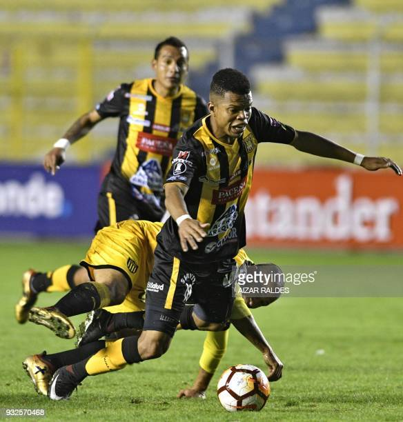 Edis Ibarguen of Bolivia's The Strongest vies for the ball with Walter Gargano of Uruguayan Penarol during their Copa Libertadores football match at...