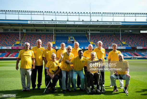 Edison Arantes do Nascimento also known as Pele pose with former players of the Brazilian and Swedish national teams of the 1958 FIFA World Cup...