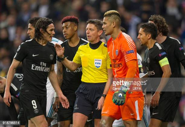 Edison Cavani of Paris SaintGermain argues with referee Gianluca Rocchi after he awarded a penalty kick during the UEFA Champions League Round of 16...