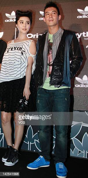 Edison Chen and Fan Bingbing pose as they attend Adidas commercial event on April 6 2012 in Beijing China